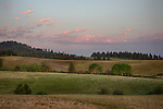 Idaho, North, Moscow. Pink clouds at dawn hover over a layered landscape of the Palouse in spring.