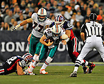 7 December 2008: Miami Dolphins' quarterback Chad Pennington is tackled on a keeper play, gaining two yards during the first regular season NFL game ever played in Canada. The Dolphins defeated the Buffalo Bills 16-3 at the Rogers Centre in Toronto, Ontario. ..Mandatory Photo Credit: Ed Wolfstein Photo