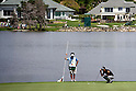 (L-R) Hiroyuki Kato, Ryo Ishikawa (JPN),.MARCH 23, 2012 - Golf :.Ryo Ishikawa of Japan lines up with his caddie on the green of 6th hole during the second round of the Arnold Palmer Invitational at Arnold Palmer's Bay Hill Club and Lodge in Orlando, Florida. (Photo by Thomas Anderson/AFLO)(JAPANESE NEWSPAPER OUT)
