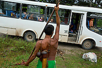 Wemane Iteka, a Waorani (Huaroni) man, takes his blow pipe on the Maxus Road bus to a hunting spot along the road. He's the only one in the Guiyero area who still makes blow pipes. It takes him a few weeks to make one and he sells them for about 200 dollars. The Maxus Road was built in the early 1990s through the jungle to allow Maxus Energy (now bought out by Repsol) access to oil deposits. Repsol also provides the free shuttle bus service for communities living along its route.