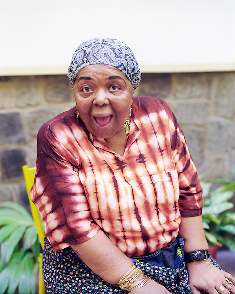 """Singer Cesaria Evora sits for a portrait at her home. Mindelo, Sao Vincente, Cape Verde Islands, Africa...Cesária Évora ( born 27 August 1941) is a Cape Verdean popular singer. Nicknamed the """"barefoot diva"""" for performing without shoes, Évora is perhaps the best internationally-known practitioner of """"morna."""""""