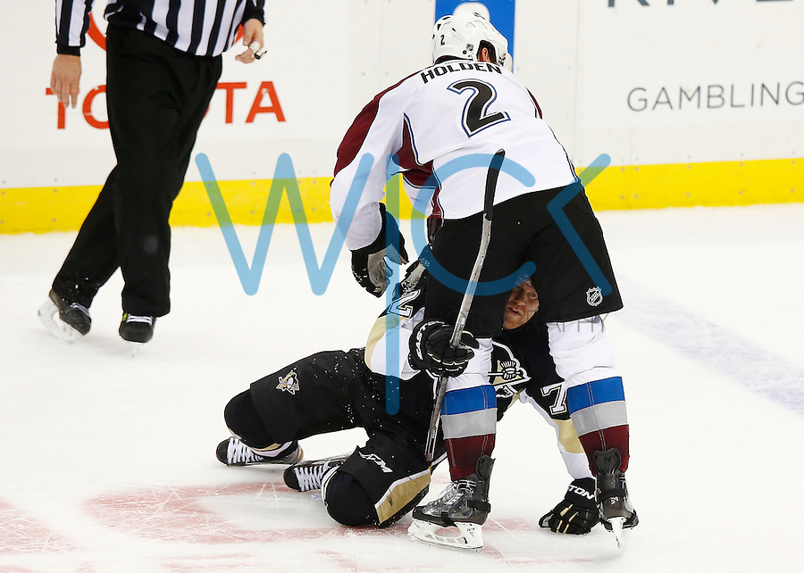 Patric Hornqvist #72 of the Pittsburgh Penguins scuffles with Nick Holden #2 of the Colorado Avalanche in the third period at Consol Energy Center during the game on November 19, 2015. (Photo by Jared Wickerham/DKPittsburghSports)