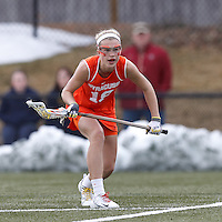Syracuse University midfielder Katie Webster (18) on the attack from free position.  Syracuse University (orange) defeated Boston College (white), 17-12, on the Newton Campus Lacrosse Field at Boston College, on March 27, 2013.