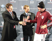 Conor Casey#9 receives the MVP trophy at MLS Cup 2010 at BMO Stadium in Toronto, Ontario on November 21 2010. Colorado won 2-1 in overtime.