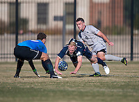 Julian Ringhof (33) of San Diego falls to the ground after being fouled by Brandon Allen (10) of Georgetown while San Diego goalkeeper (0) Drew Ilijevski collects the ball during the game at North Kehoe Field in Washington, DC.  Georgetown defeated San Diego, 3-1.