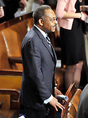 Washington, DC - March 4, 2009 -- United States Senator Roland Burress (Democrat of Illinois) stands at his seat on the floor of the U.S. House of Representatives to await the arrival of Prime Minister Gordon Brown of the United Kingdom who will address a Joint Session of the United States Congress in the U.S. Capitol in Washington, D.C. on Wednesday, March 4, 2009..Credit: Ron Sachs / CNP
