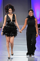 Fashion designer Simone Rodrigues walks the runway with a model at the close of her SISA Designs Spring 2012 fashion show, during Couture Fashion Week Spring 2012.