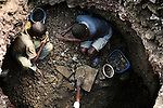 LUBUMBASHI, DEMOCRATIC REPUBLIC OF CONGO - DECEMBER 14: Young boys search for copper on December 14, 2005 in Ruashi mine about 20 kilometers outside Lubumbashi, Congo, DRC. They are some of about 4,000 young men and children who work here. Some children as young as eight work in the mine under dangerous conditions.  Every month a few of the miners are killed. Congo has one of the largest Copper deposits in the world and most of it is exported to China. It?s fueling the thirst for minerals for China?s economic boom. The young men who works in the mine makes a few US dollars a day, and the children much less. The mine is about one hundred years old and has been a source of wealth for the Katanga province for many years. In recent years many foreign companies and shady business people has moved into Congo to plunder its wealth. The country has no elected government and the corruption is rife. Border and customs officials are easily bribed. Congo has had a civil war since 1997 and it?s estimated that nearly 4 million people has died in fighting and because of lack of health care. (Photo: Per-Anders Pettersson/Getty Images)