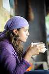 A hiker relaxes with hot chocolate at a refuge in  Acaime Nature Reserve in central Colombia's enchanting Valle de Cocora.   The hike passes from green grasslands and a warm climate, through dense, semi-tropical jungle, and finally to cool, breezy mountain vistas at around 3,000 meters.