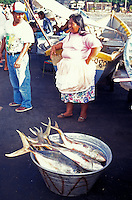 Woman selling freshly caught fish on the town pier in La Libertad, El Salvador