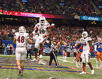 Louisville running back Jeremy Wright celebrates with teammates after scoring a touchdown during 79th Sugar Bowl game against Florida at Mercedes-Benz Superdome in New Orleans, Louisiana on January 2nd, 2013.   Louisville Cardinals defeated Florida Gators, 33-23.