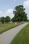 Valley Forge National Historical Park.  Hiker on path,. .Philadelphia, Pennsylvania, PA USA.  Photo copyright Lee Foster, 510-549-2202, lee@fostertravel.com, www.fostertravel.com.  Photo 366-30376