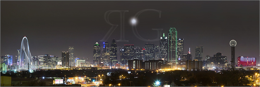 On a cold December evening, the Dallas skyline comes alive with color. From left to right, the architecture of Dallas offers the Margaret Hunt Hill Bridge, the Trammell Crow Tower, the Fountain Place, Lincoln Plaza, the Harward Center, Energy Plaza, the Renaissance Tower, the Bank of America Plaza, the CoAmerica Bank Tower, the Hyatt Regency Dallas,  the iconic Reunioin Tower, and the Omni Hotel Dallas (the blue and red building). Also, the full moon rising over the city peaked through the low clouds...Thanks to the Belmont Hotel for provided this vantage point. They were great to work with.