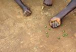 Boys play marbles using seeds in Despagne, an isolated village in southern Haiti where the Lutheran World Federation has been working with residents to improve their quality of life.