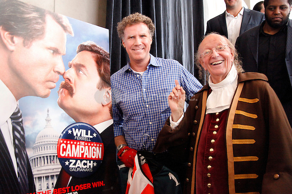 Will Ferrell and Zach Galifianakis add their signatures to a commemorative copy of the Constitution in honor of it's 225 anniversary as part of a nationwide tour to promote their new movie The Campaign at the National Constitution Center in Philadelphia, Pa on July 31, 2012  © Star Shooter / MediaPunchInc