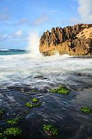 At sunrise, powerful waves crash against the pinnacles along Maha'ulepu Heritage Trail, southern Kaua'i.