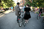 Bike Prom participants prepare for the event at the Living Arts and Science Center on North Martin Luther King Boulevard by planning out a bike route Saturday evening. Photo by Adam Wolffbrandt | Staff.