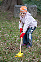 Caucasian Kid Girl Raking Leaves
