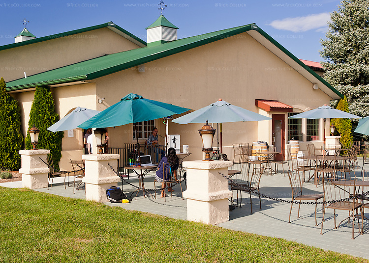 A musician entertains on the patio, outside the tasting room at Breaux Vineyards.