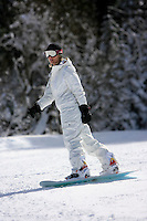 24 February 2008: Snowboarder wearing white comes off the mountain after a late winter storm in Lake Tahoe, Truckee Nevada California border in the Sierra Mountains.