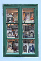 Window display of books sold at Kafka House, no. 22 Golden Lane, within the northern bailey area of Prague Castle, which was inhabited 1916-17 by Franz Kafka, 1883-1924, Czech writer and philosopher, Prague, Czech Republic. The Golden Lane contained modest dwellings, which are now the last remains of the small-scale architecture of Prague Castle. They were inhabited by the castle servants, perhaps goldsmiths (hence the name) and the castle marksmen. The tiny houses were occupied until World War II, and have been preserved since then. The historic centre of Prague was declared a UNESCO World Heritage Site in 1992. Picture by Manuel Cohen