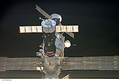 In Earth Orbit - July 6, 2006 -- Solar arrays and a couple of Russian spacecraft docked to the International Space Station appear very near in this digital photograph, recorded by one of the STS-121 crewmembers onboard the Space Shuttle Discovery prior to the docking of shuttle to the orbital outpost. A Progress vehicle is near center and another is docked to the Zvezda service module in the background..Credit: NASA via CNP