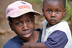 Jean Manuel Dupres, 13, holds his brother Jefte in Despagne, a rural village in southern Haiti where the Lutheran World Federation has been working with residents to improve their quality of life.
