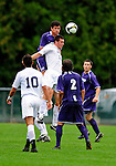 13 September 2009: University of Portland Pilots' defenseman/forward Logan Emory, a Senior from Boise, Idaho, jumps above University of New Hampshire Wildcats' midfielder/forward Charlie Roche, a Freshman from Haverhill, MA, during the second round of the 2009 Morgan Stanley Smith Barney Soccer Classic held at Centennial Field in Burlington, Vermont. The Pilots defeated the Wildcats 1-0 and inso doing were the Tournament Champions for 2009. Mandatory Photo Credit: Ed Wolfstein Photo