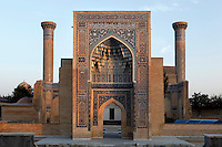 General view of Monumental arch, Gur-Emir Mausoleum, 1417-20, Samarkand, Uzbekistan, pictured on July 14, 2010, in the afternoon. Gur-Emir Mausoleum, or Tomb of the Ruler, was built by Timur in 1404 for his favourite grandson, Mohammed Sultan, and became the mausoleum for the Timurid dynasty. Samarkand, a city on the Silk Road, founded as Afrosiab in the 7th century BC, is a meeting point for the world's cultures. Its most important development was in the Timurid period, 14th to 15th centuries. Picture by Manuel Cohen.