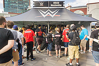 Wrestling fans buy souvenirs and other memorabilia prior to the WWE SummerSlam event at the Barclays Center in Brooklyn in New York on Saturday, August 20, 2016.  (© Richard B. Levine)