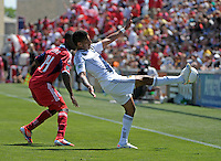 LA Galaxy defender Sean Franklin (5) knocks the ball down in front of Chicago midfielder Patrick Nyarko (14).  The LA Galaxy defeated the Chicago Fire 2-0 at Toyota Park in Bridgeview, IL on July 8, 2012.