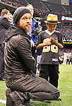 "NFL Saints -Actor Brad Pitt and his adopted son Maddox walk on the New Orleans Saints side line before the NFC playoff game between the Saints and the Cardinals Saturday jan. 16, 2010 in Louisiana at the SuperDome. Brad has been instrumental in rebuilding the lower ninth ward in New Orleans through his Make it Right non profit that is building ""green homes"" where Hurricane Katrina destroyed everything. The Saints beat the Cardinals to advance in the playoffs. Photo ©Suzi Altman/Suzisnaps.comNFL Saints -Cardinals playoffs. Photo ©Suzi Altman/Suzisnaps.comNFL Saints -Cardinals playoffs. Photo ©Suzi Altman/Suzisnaps.com"
