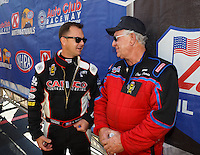 Feb 14, 2016; Pomona, CA, USA; NHRA top fuel driver Steve Torrence (left) talks with Steve Faria during the Winternationals at Auto Club Raceway at Pomona. Mandatory Credit: Mark J. Rebilas-USA TODAY Sports