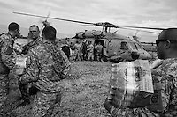 Port au Prince, Haiti, Jan 19, 2010.Collaboration between several nations logistical means (here US Navy helicopters) and the WFP is gearing up and very efficient considering the amplitude of the disaster.
