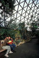 Tourists birdwatching in the Bloedel Floral Conservatory in Queen Elizabeth Park, Vancouver, British Columbia, Canada