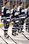 John Henrion (UNH - 16), Mike Borisenok (UNH - 14), Justin Agosta (UNH - 12) - The University of Maine Black Bears defeated the University of New Hampshire Wildcats 5-4 in overtime on Saturday, January 7, 2012, at Fenway Park in Boston, Massachusetts.