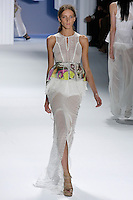 Iris Egbers walks runway in a White silk chiffon eyelet tiered top with white psychedelic printed peplum drawstring belt, and White silk chiffon eyelet maxi skirt by Vera Wang, for the Vera Wang Spring 2012 collection, during Mercedes-Benz Fashion Week Spring 2012.