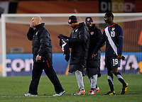 USA manager Bob Bradley shows his disbelief while walking off the field with Maurice Edu