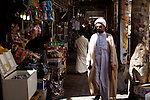 NAJAF, IRAQ: An imam walks through the Najaf market...Daily life continues in relative peace in the Iraqi city of Najaf...Photo by Ali Arkady/Metrography