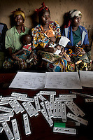 Women and children are tested for Malaria at MSF's mobile clinic in the remote village of Kashuga, North Kivu, DRC.