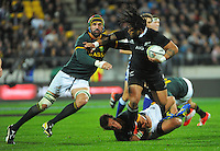 Ma'a Nonu is tackled during the Rugby Championship international rugby test match between New Zealand All Blacks and South Africa Springboks at Westpac Stadium, Wellington, New Zealand on Saturday, 13 September 2014. Photo: Dave Lintott / lintottphoto.co.nz