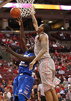 Ohio State Buckeyes forward LaQuinton Ross (10) knocks away a shot by Central Connecticut State Blue Devils forward Faronte Drakeford (22) in the second half of the college basketball game between the Ohio State Buckeyes and the Central Connecticut State Blue Devils at Value City Arena in Columbus, Saturday afternoon, December 7, 2013. The Ohio State Buckeyes defeated the Central Connecticut State Blue Devils 74 - 56. (The Columbus Dispatch / Eamon Queeney)