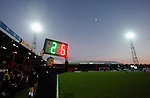 Grimsby Town 1 Lincoln City 3, 28/12/2014. Blundell Park, Football Conference. The fourth official shows the numbers board for a substitution.  Photo by Paul Thompson.