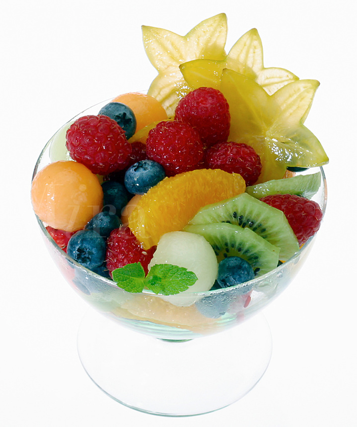Fruit Salad in Clear Galss dish on white background