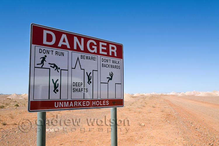 Danger sign warning of open mine shafts in the opal fields of Coober Pedy, South Australia, AUSTRALIA.