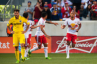 Thierry Henry (14) of the New York Red Bulls celebrates scoring with Tim Cahill (17) during the first half against the Columbus Crew. The New York Red Bulls and the Columbus Crew played to a 2-2 tie during a Major League Soccer (MLS) match at Red Bull Arena in Harrison, NJ, on May 26, 2013.