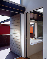 This bath fits between an exterior deck and the interior with sliding panes that offer protection if required