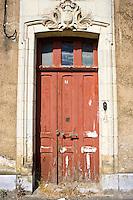 Weathered doorway in Ballee, Normandy, France