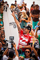 HONOLULU - (Friday, December 14, 2012) Joel Parkinson (AUS) celbrating his World Title win by winning the Pipe Masters..-- The BILLABONG PIPE MASTERS In Memory of Andy Irons  concluded today in spectacular way. The 2012 ASP World Title was decided between Joel Parkinson (AUS) and Kelly Slater (USA) with Parkinson finally holding the World Title trophy above his head in front of thousands of surf fans..Slater was defeated by Josh Kerr (AUS) in the semi finals finishing his chance of winning a 12th World Title. Waves were  in the 6 to 8-feet for most of the day..Sebastien Zietz (HAW) won the 2012 Vans Triple Crown of Surfing title winning $100,000, a Harley Davidson motorcycle and a $10,000 Nixon watch..Photo: joliphotos.com