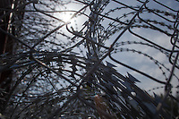 Stack of razor wire attached on a cargo train sealing an opening on the fence on the border between Serbia and Hungary near Roszke (about 174 km South of capital city Budapest), Hungary on September 15, 2015. ATTILA VOLGYI